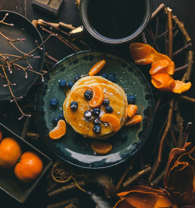 Canva - A Flatlay of Oranges and Pancakes