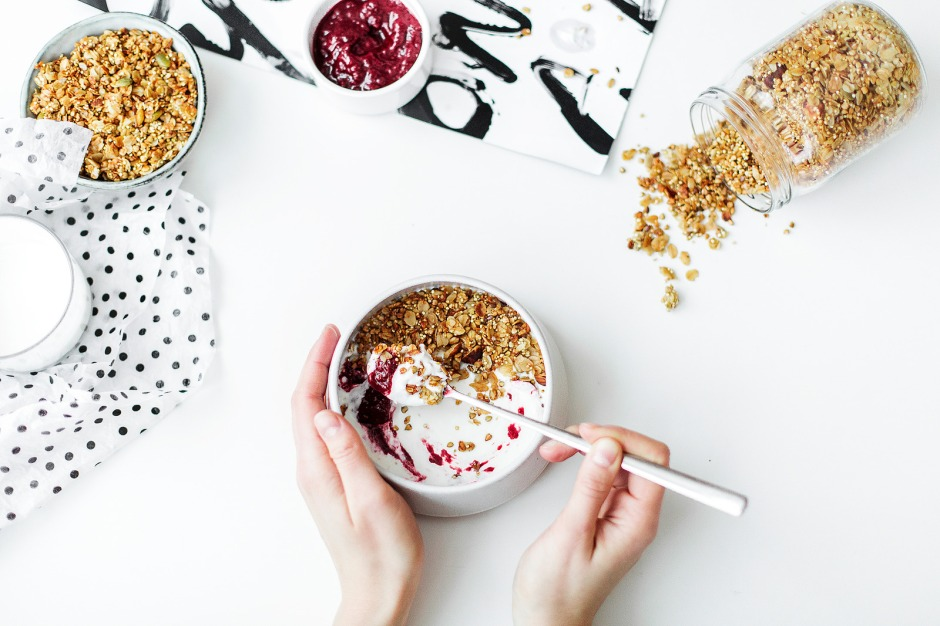 Photo by Daria Shevtsova - Person Mixing Cereal, Milk, and Strawberry Jam on White Ceramic Bowl