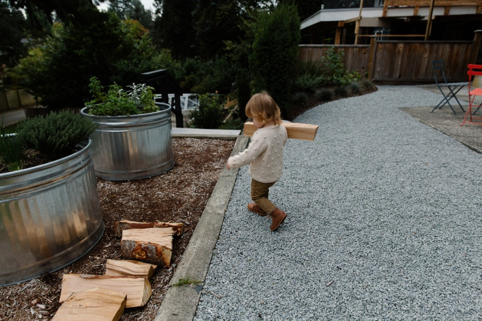 Canva - Girl iI White Long Sleeve Shirt And Brown Pants Holding Firewood