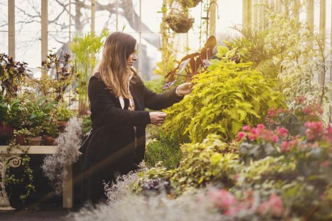 Canva - Woman in Black Long Sleeve Dress Holding Flowers