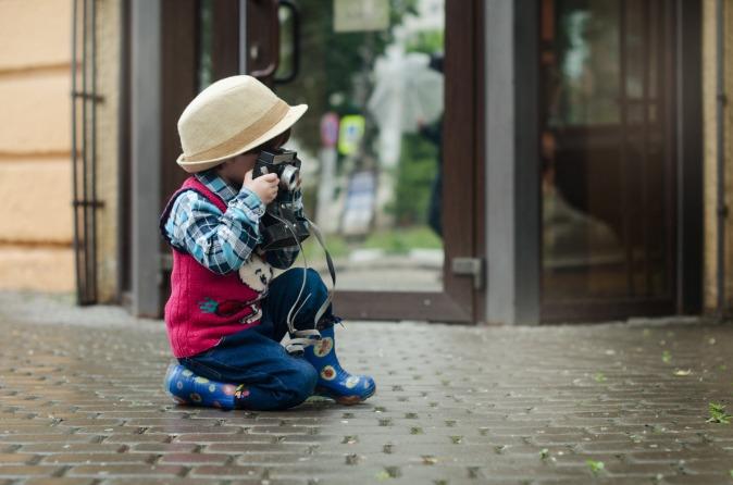 Canva - Boy Taking a Photo Using Camera