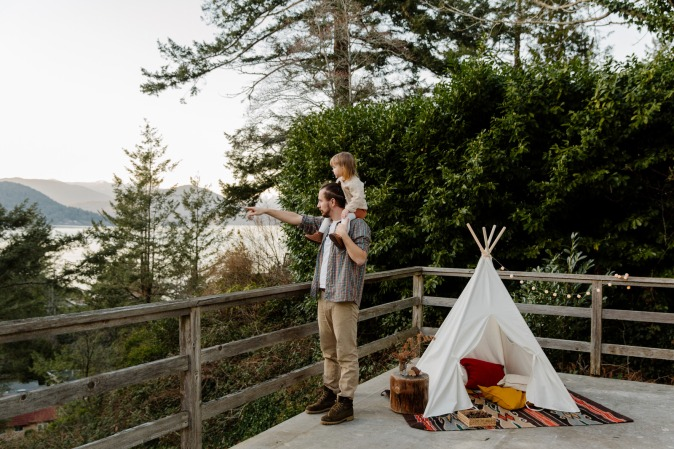 Canva - Father and kid on terrace with picturesque view
