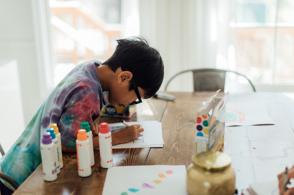 Canva - Kid drawing at home