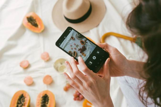 Canva - Photo Of Person Taking Picture Of Fruits