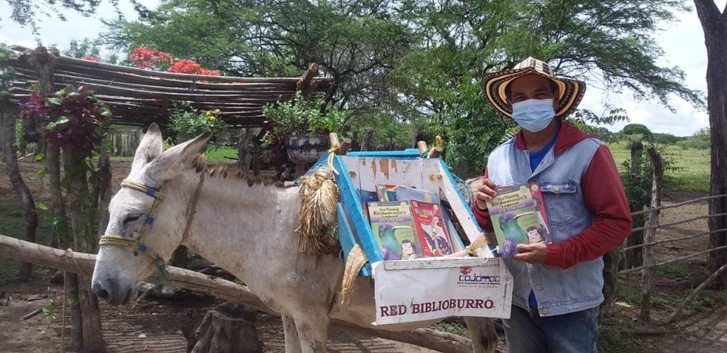 Biblioburro delivering bilingual books of the Adventures of Pili in Colombia